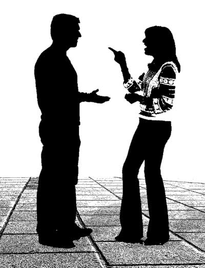 Silhouettes of man and woman having a conversation