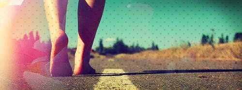 Feet walking on a road