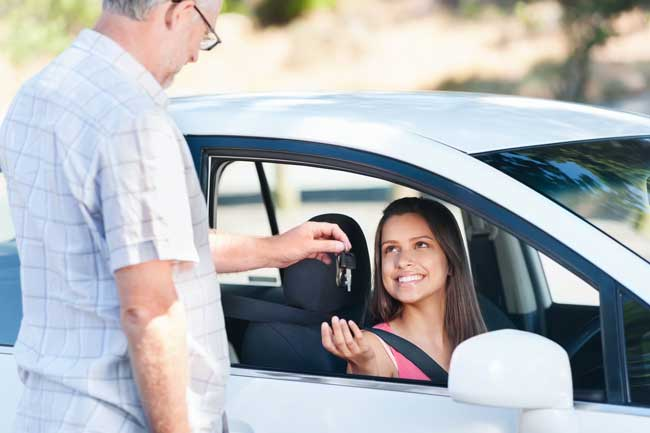 Teen getting car keys from father