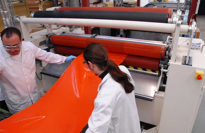 Leather technologists working in factory