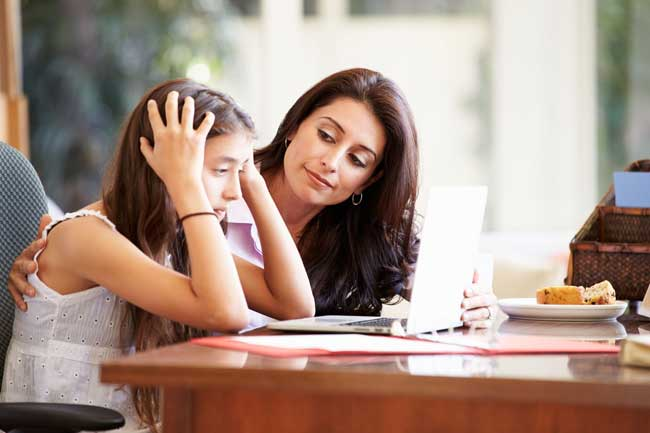 Mother helping stressed teen daughter