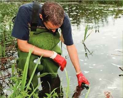 Environmental Engineer collecting water samples