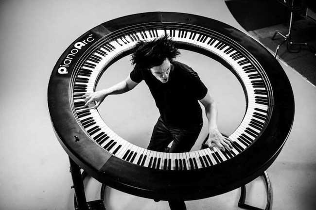 Circular piano played by Brockett Parsons