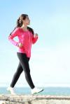 Healthy girl walking briskly