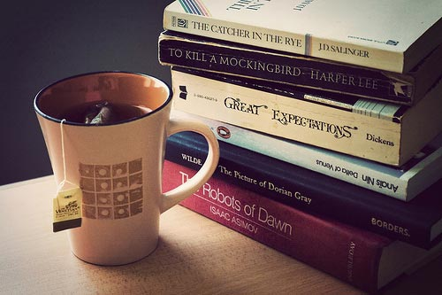 Cup of tea near a stack of books