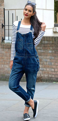 Girl wearing dungarees with a striped top