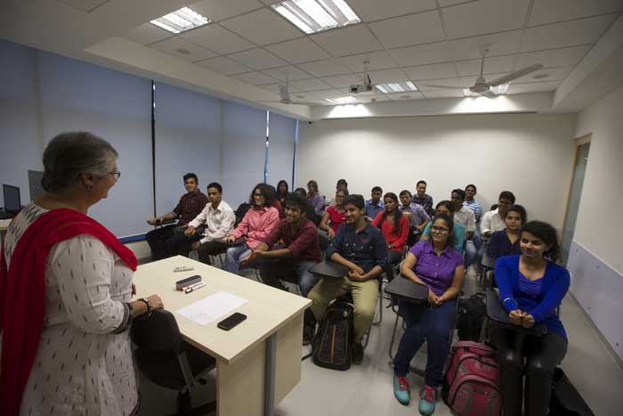 Professor talking to students at SPICE, Mumbai