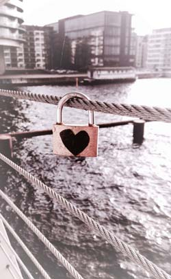 Lock with heart suspened on a rope
