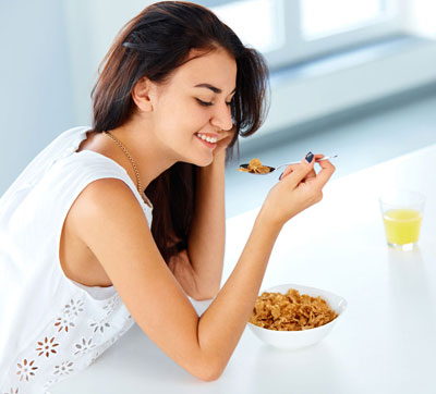 Young woman eating cereal