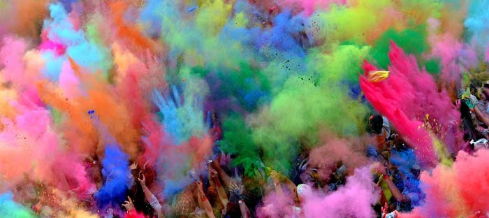 People throwing colour at Holi