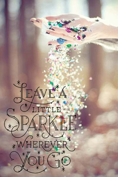 Hands sprinkling shiny confetti