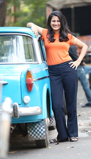 Pallavi Singh poses near a car