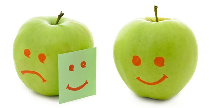 Green apples smiling, crying and looking envious