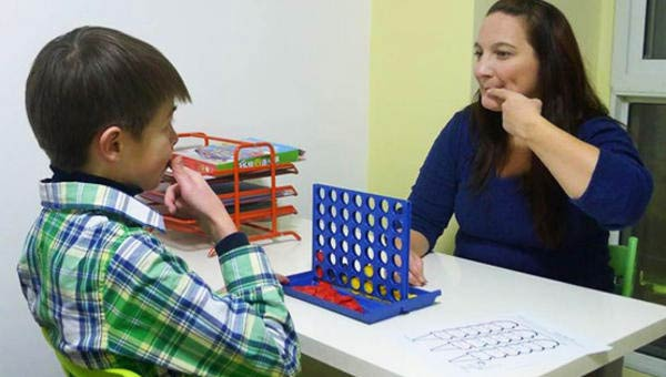 Speech therapist and child in a therapy session