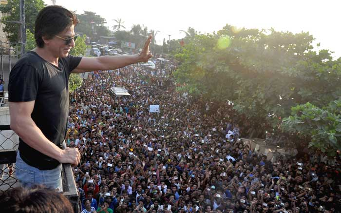 Bollywood superstar Shah Rukh Khan waving to fans outside his home Mannat
