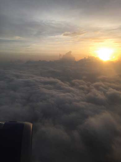 Sun peeking out above the clouds