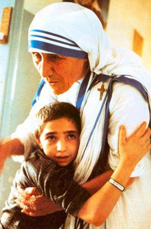 Mother Teresa hugging a small boy