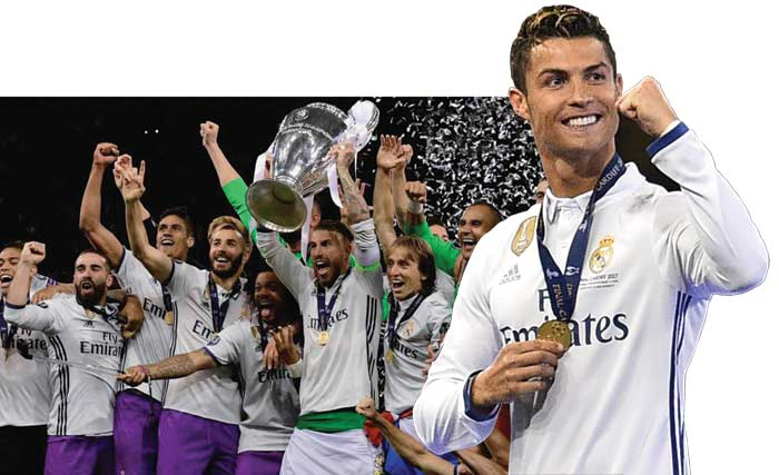 Cristiano Ronaldo with Real Madrid team lifting the Champions League 2017 trophy