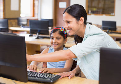 Teacher and student in computer class