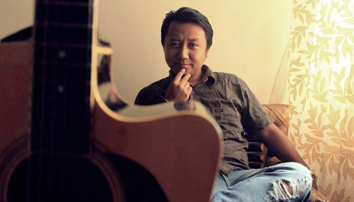 Abhishek Gurung with a guitar