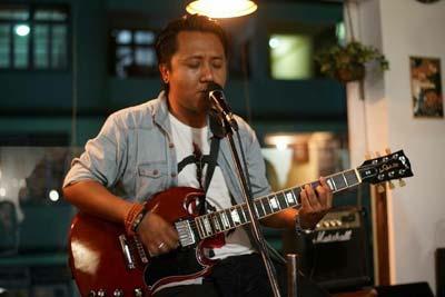 Abhishek Gurung singing and playing guitar