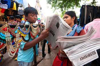 A Balaknama team member distributing the newspaper