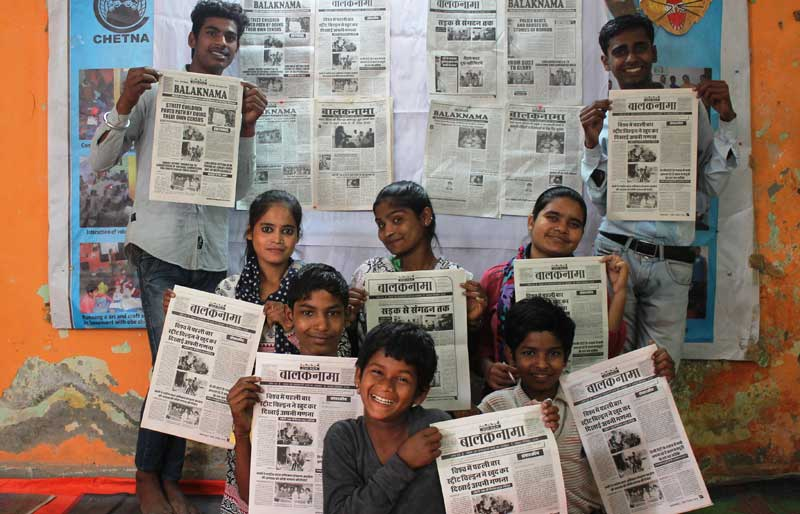 Editorial team of Balaknama holding up their newspaper