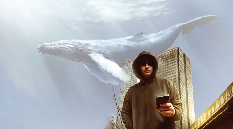 Teen playing mobile game against a backdrop of a blue whale