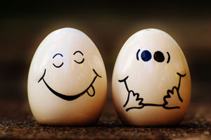 Two eggs with funny faces drawn on them