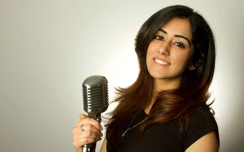Jonita Gandhi with a mike