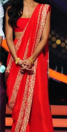 Katrina Kaif wearing a red palazzo saree