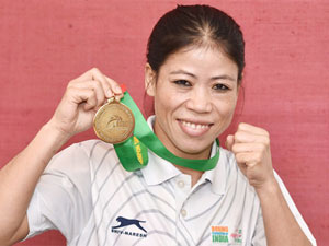 Indian boxer Mary Kom holding the gold medal she won at the Asian Boxing Championships