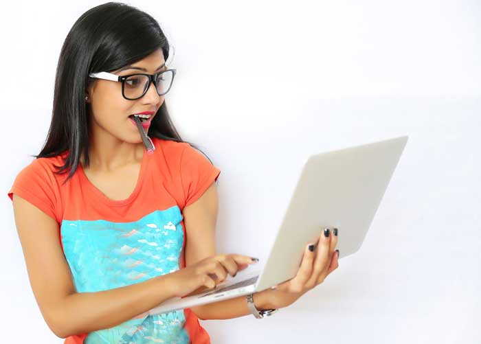 Young female student working on a laptop
