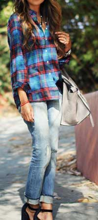 Female model wearing boyfriend jeans and plaid shirt