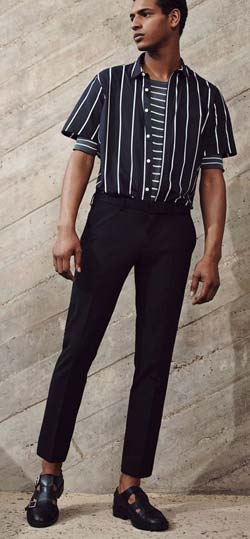 Guy wearing striped black and white shirt with black trousers