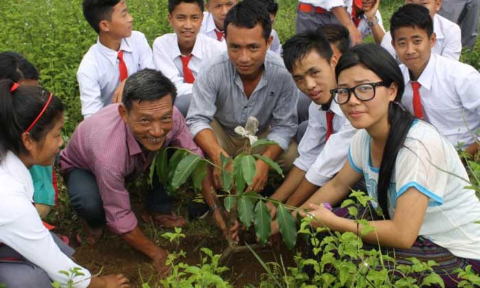 Students of Newman School, Changlang, Arunachal planting saplings
