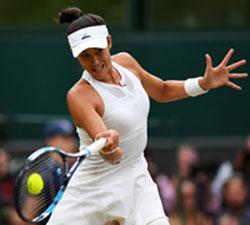 Garbine Muguruza plays a shot at the Wimbledon Championships