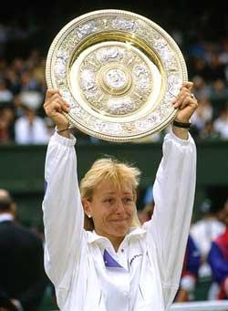 Martina Navratilova holds aloft the Wimbledon trophy