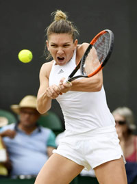 Simona Halep plays a shot at the Wimbledon Championships