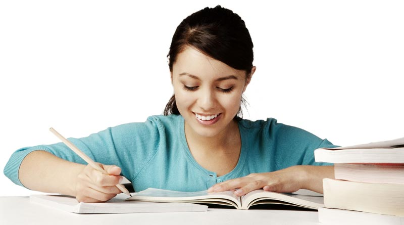 Young girl happily studying and revising