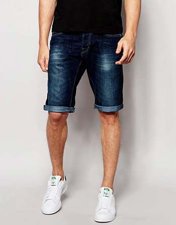 Guy wearing long denim shorts