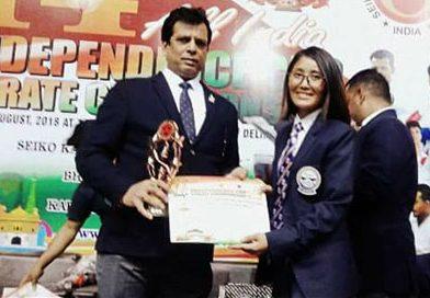 Tshering Yanki Bhuta receives a trophy from Mr Hanshi Bharat Sharma