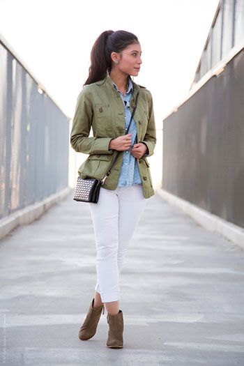 Model wearing white jeans and olive green jacket