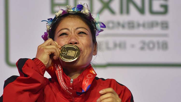 Indian boxer Mary Kom kisses the gold medal at the AIBA Women's World Boxing Championship 2018