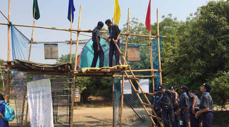 Scouts constructing a platform