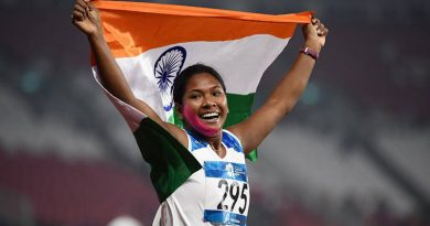 Swapna Barman carrying the Indian flag