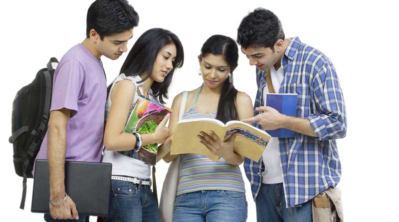 A group of four college students studying together