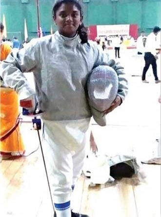 Siddhi Misal in her fencing gear
