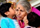 Sindhutai kissing two small children