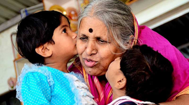 Sindhutai kissing two small children